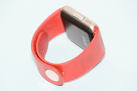 red and golden smart wrist watch and phone Stock Photo