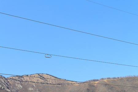 quencher: The limiter of icing and fluctuations in the form of a paper-clip on electric wires among mountains