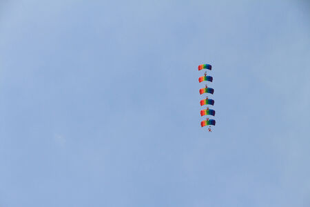 parachutists: Parachutists represent a figure in the sky with color parachutes