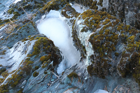 crevice: Crack in the rock filled with ice and snow