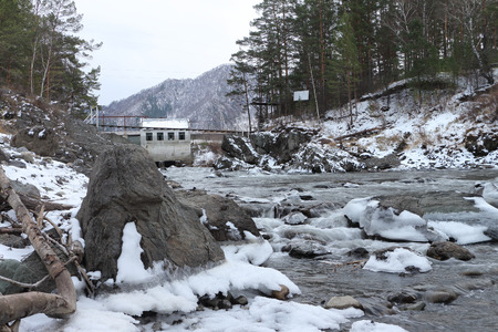 chemal: The old hydroelectric power station on the river Chemal after a flood in mountain Altai in Russia