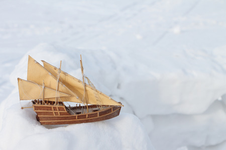 schooner: The toy sailing schooner standing on snow in the winter outdoors