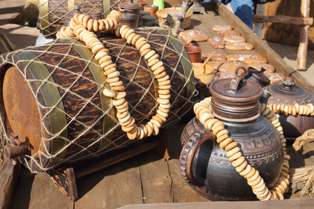 wine trade: The pastries lying on a barrel and a jug in a trade row on a counter Stock Photo