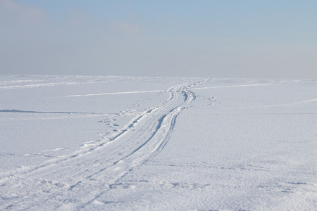twisting: The twisting road on the snow-covered river in the winter