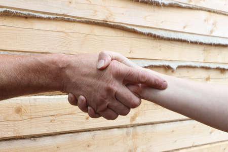 suntanned: Suntanned male and female hands make handshake