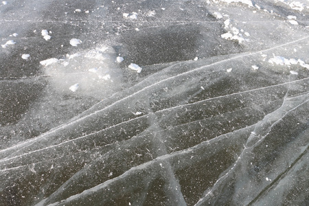 deepening: Crack on an ice surface of the frozen river, a natural background