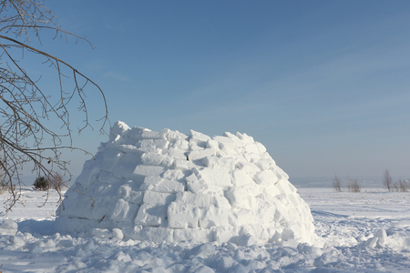 glade: Construction an igloo on a snow glade in the winter Stock Photo