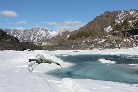 katun: Opening of ice on the turquoise Katun River in the spring near Oroktoysky Bridge, Altai, Russia