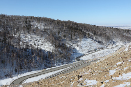 lacet: Mountain  highway among snow slope , Belokurikha,  Altai, Russia