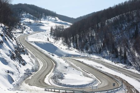 belokurikha: Mountain  highway among snow slope , Belokurikha,  Altai, Russia