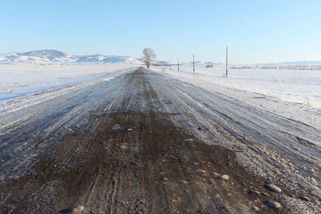 snow fields: The rural unpaved road  going among snow fields