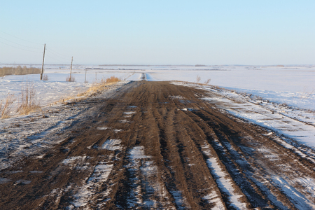 rut: The rural unpaved road  going among snow fields