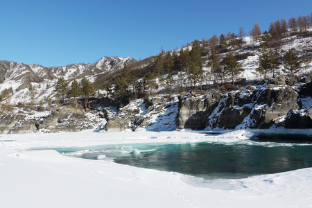 katun: Opening of ice on the turquoise Katun River in the spring in Chemalsky district, Altai, Russia Stock Photo