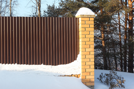 Brown corrugated iron fence, metal background
