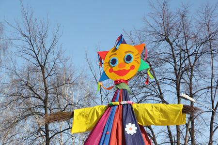effigy: Effigy of shrovetide standing against the background of the blue sky Stock Photo