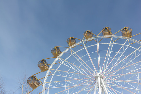 Ferris wheel  with the round closed cabins against the background of the sky Stock Photo