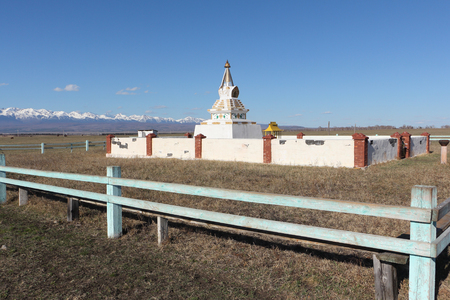 sacral: Buddhist stupa in the Tunkinsky valley against the background of the Sayan mountains, Buryatia, Siberia Stock Photo