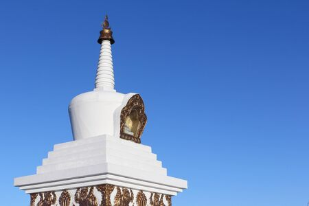Buddhist stupa  against the background of the blue sky, a detail, Buryatia, Russia