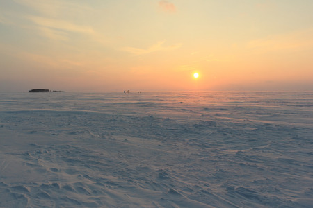 Sunset on the frozen river in winter,  Ob River, Siberia, Russia