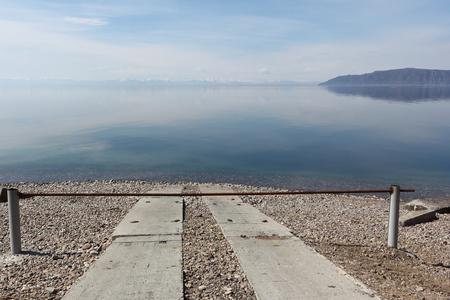 overcast: View of Lake Baikal from the waterfront, Listvyanka settlement, Siberia, Russia Stock Photo