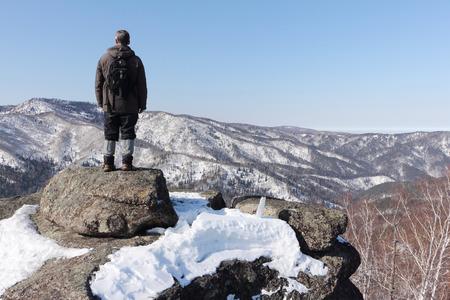 Man standing at the top of the mountain, Mountain Round, Belokurikha city, Altai, Russia