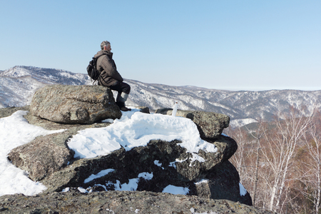 Man sitting at the top of the mountain, Mountain Round, Belokurikha city, Altai, Russia Stock Photo