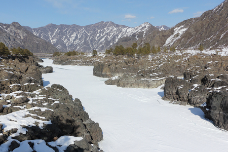 Frozen Katun River, rapids Teldykpen near the Oroktoi Bridge, Altai, Russia