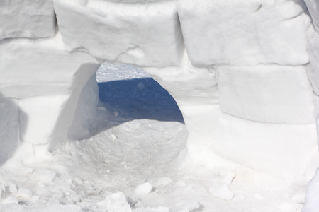 Entrance to the snow construction of an igloo