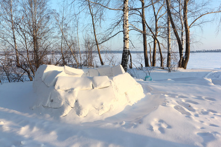 Igloo unfinished on a snow glade in the winter, Siberia, Russia