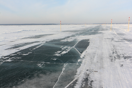 Ice road,  river crossing on the Ob reservoir, Novosibirsk region, Western Siberia, Russia