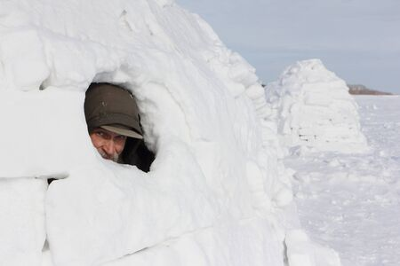 Head of a man sitting in an igloo in winter Stock fotó