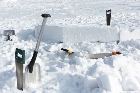 Tools in the snow for building an igloo