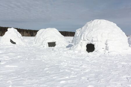 Igloo  standing on a snowy glade  in the winter, Novosibirsk, Russia 版權商用圖片