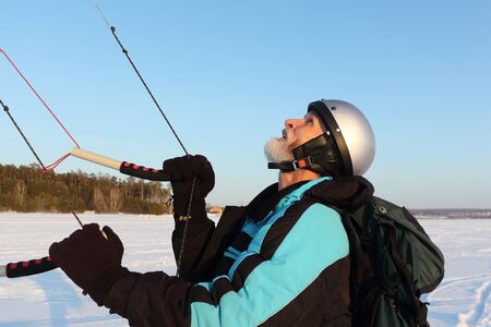 Kiteboarder holding a kite in hands in the winter, Novosibirsk, Russia
