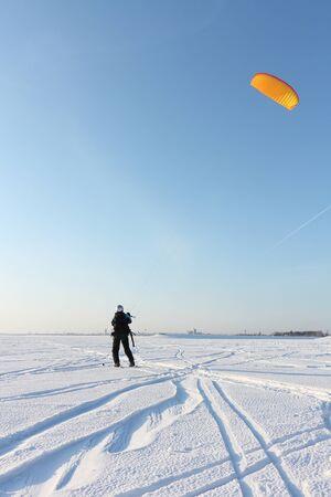 Man training in snow kiting on frozen reservoir, Novosibirsk, Russia Stock Photo