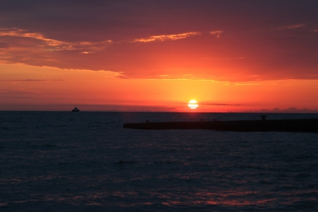 disappears:  The sun at sunset disappears for the horizon