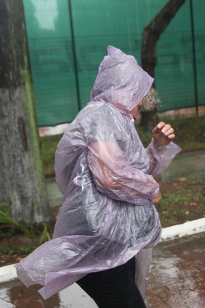 dampness: The person in a raincoat during a rain