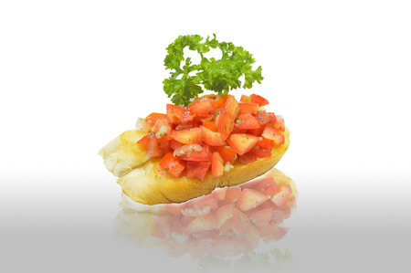 tomato bruschetta onreflection on white background photo