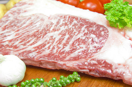 Kamui Wagyu Beef Strip Lloyd marble high red meat on a plate of fresh fruit and vegetables  Stock Photo