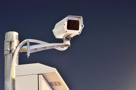 CCTV cameras are working at night On a blue background bangkok thailand photo