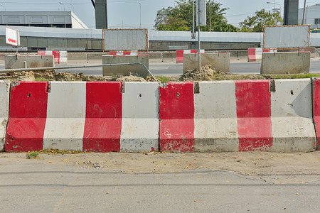 one lane road sign: Platforms Concrete Barrier red white area road construction.