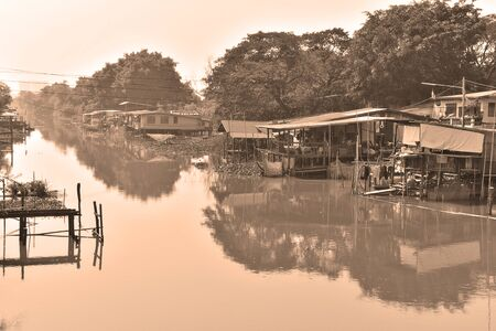 handlers: Rural villages along the canal side, Pratumtani Province  handlers style sepia photos . Stock Photo