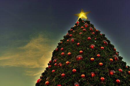 gradually: The Christmas tree is gradually opened fire at twilight retro style. Stock Photo