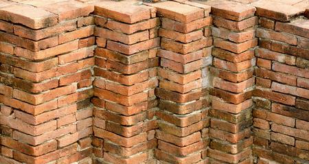 Corner of brick walls stacked photo