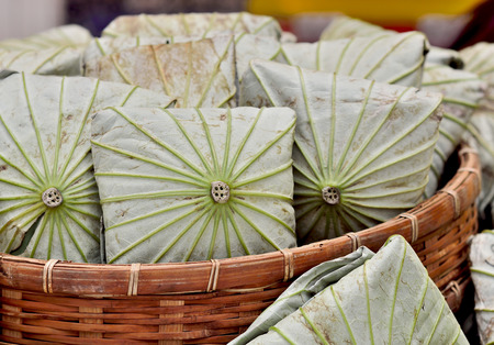 Rice wrapped in lotus leaves. photo