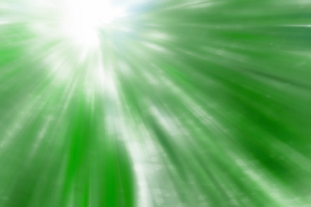 epicenter: Motion blurred green explosion ,green leaves background