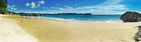 beach panorama: Beach panorama at Phanga Thailand with blue sky. Stock Photo