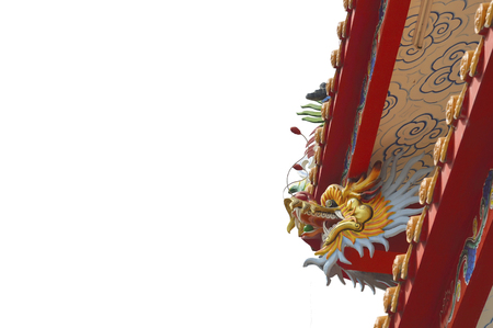 Old Chinese dragon statue on the shrine on white background. Stock Photo