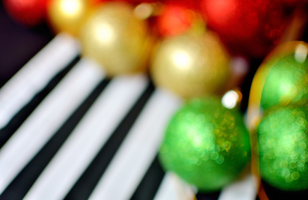 solf and blured focus christmas ball on black tablecloth