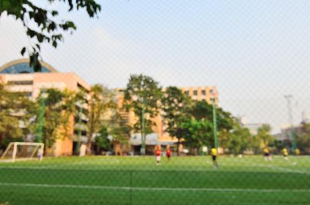 solf snd blured focus  playing football Standard-Bild